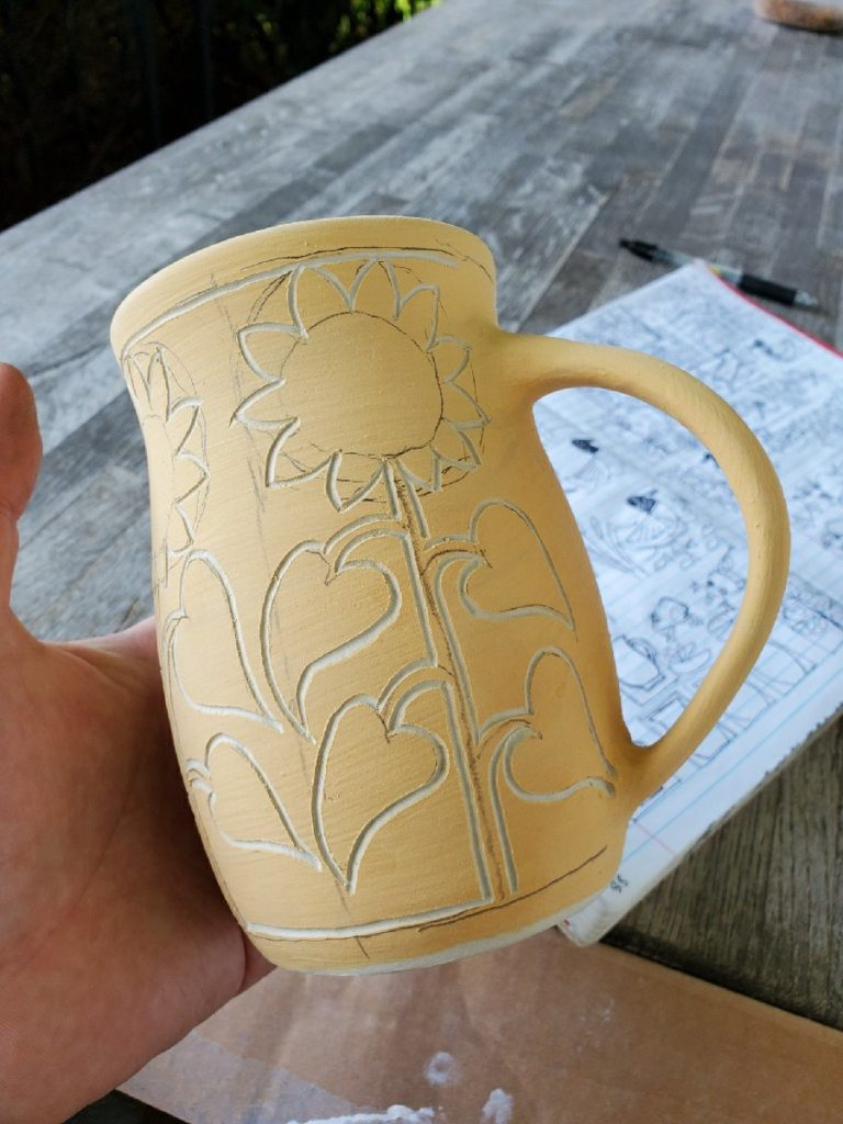 mug with sgraffito lines carved