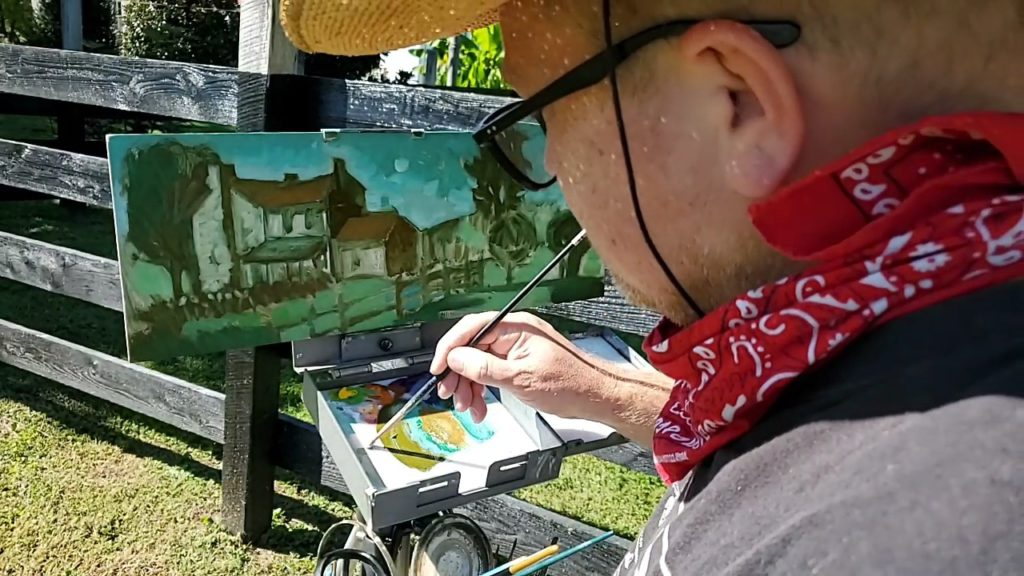close up of artist painting stone house in May's Lick, Kentucky
