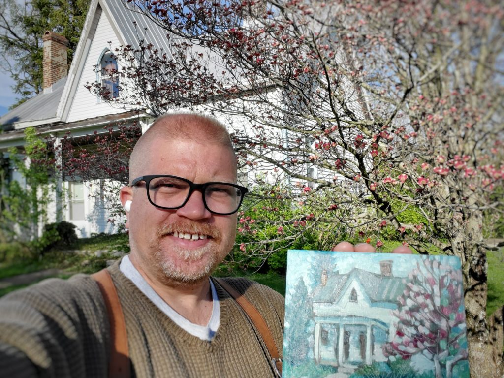 artist standing in front of house with plein air painting in Old Washington, Kentucky