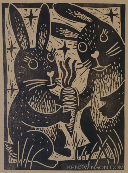 linocut of two bunnies sharing a carrot
