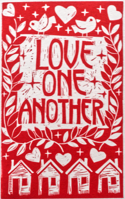 red linocut with houses and hearts with text Love One Another