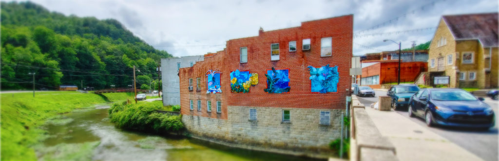 photo of public art on building beside creek in whitesburg kentucky