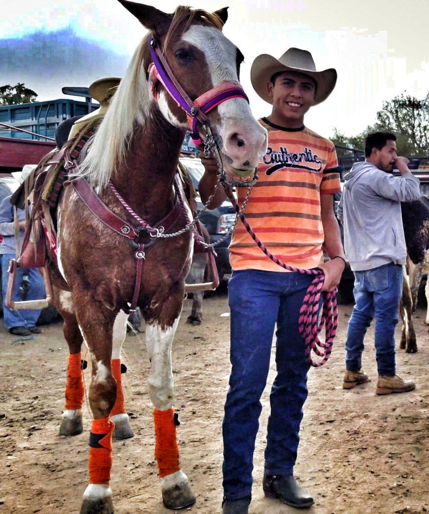 young cowboy with a horse in etla oaxaca mexico