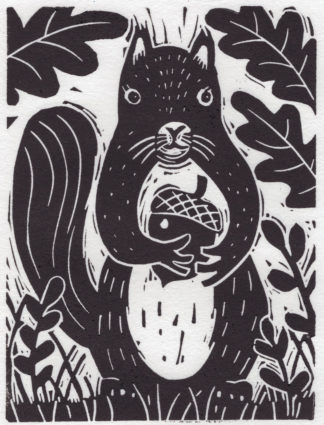 linocut of squirrel holding acorn