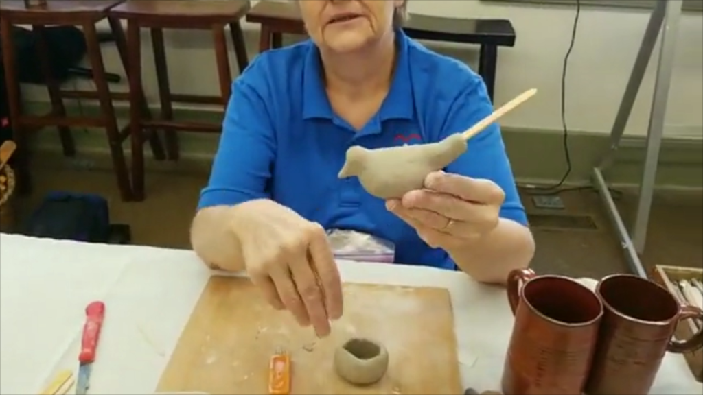 woman making a clay whistle in old washington kentucky