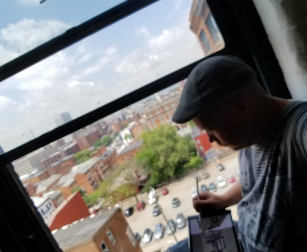 kentucky artist sketching the view of cincinnati ohio with an ipad v
