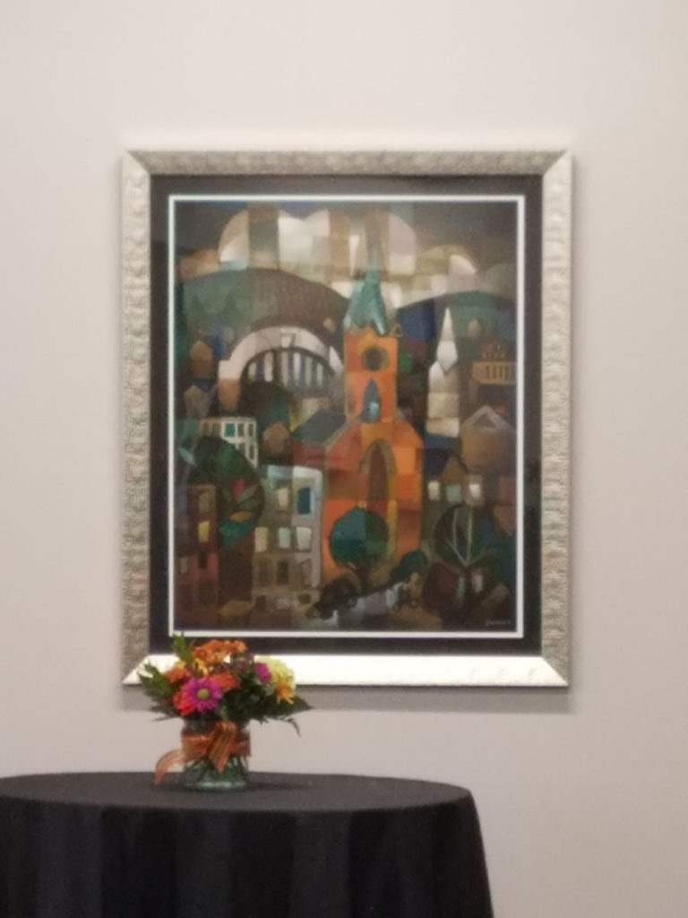 artist ken swinson paintings of cincinnati framed and on display with still life of flowers