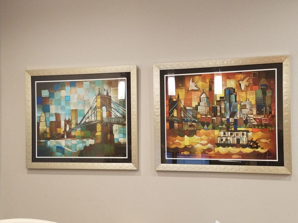 ken Swinson paintings of cincinnati framed and on display