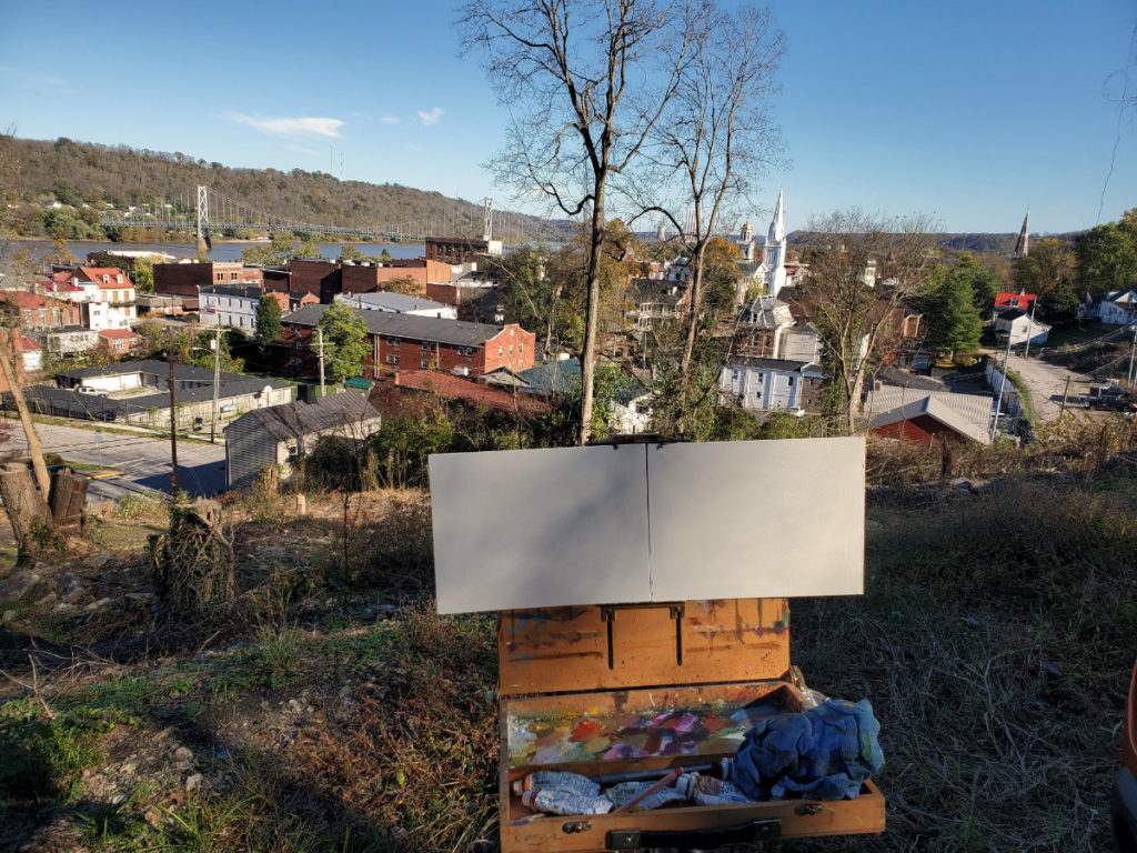 plein air easel setup in front of panoramic view of downtown maysville kentucky