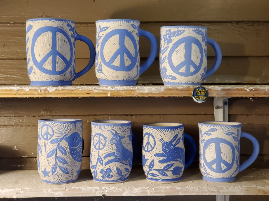 porcelain mugs - work in progress - blue with different peace symbols