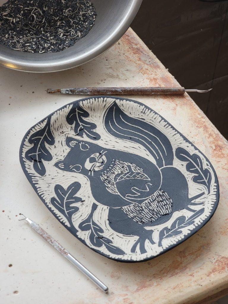 Sgraffito plate with squirrel and acorn decoration porcelain