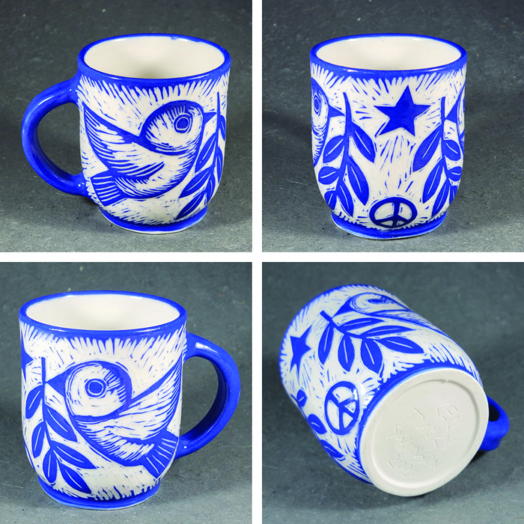 porcelain mug with blue design of birds carrying olive branch and peace symbol