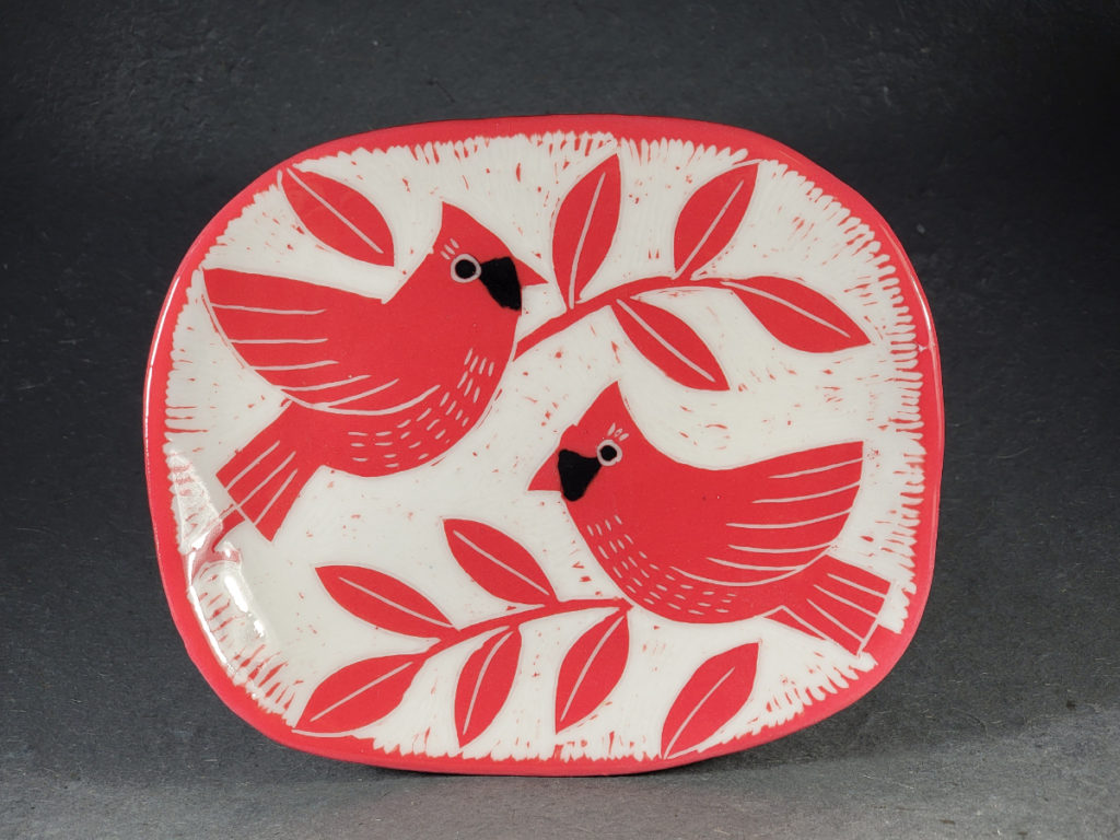 red porcelain plate with cardinal design