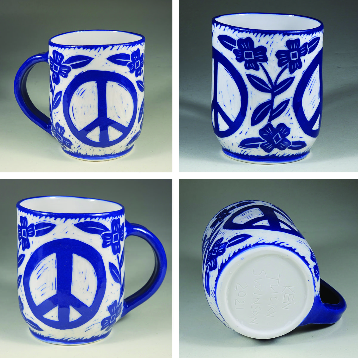 porcelain cup with blue sgraffito peace symbol and flowers