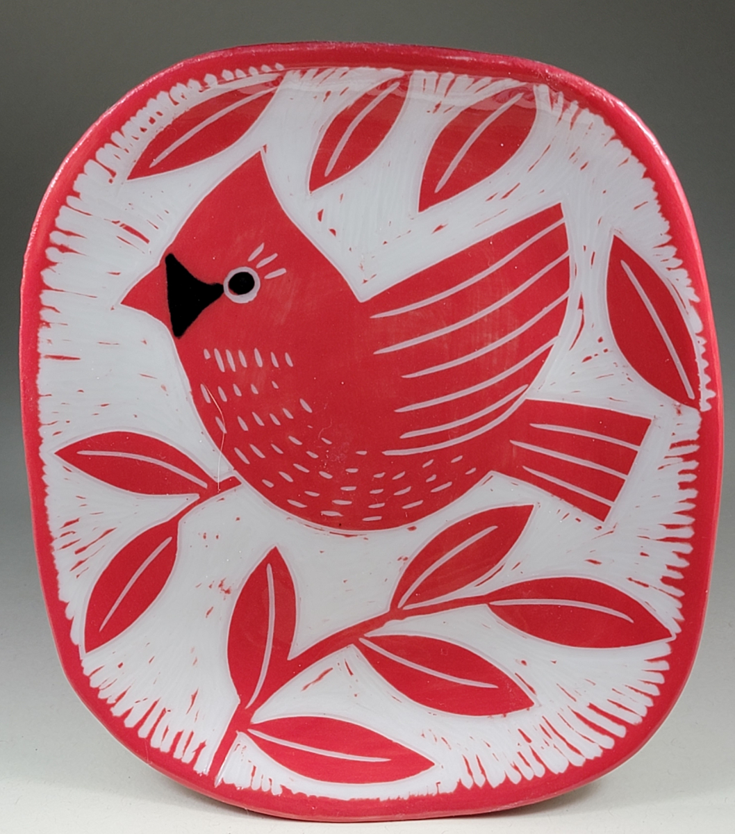 porcelain plate with red cardinal sgraffito design