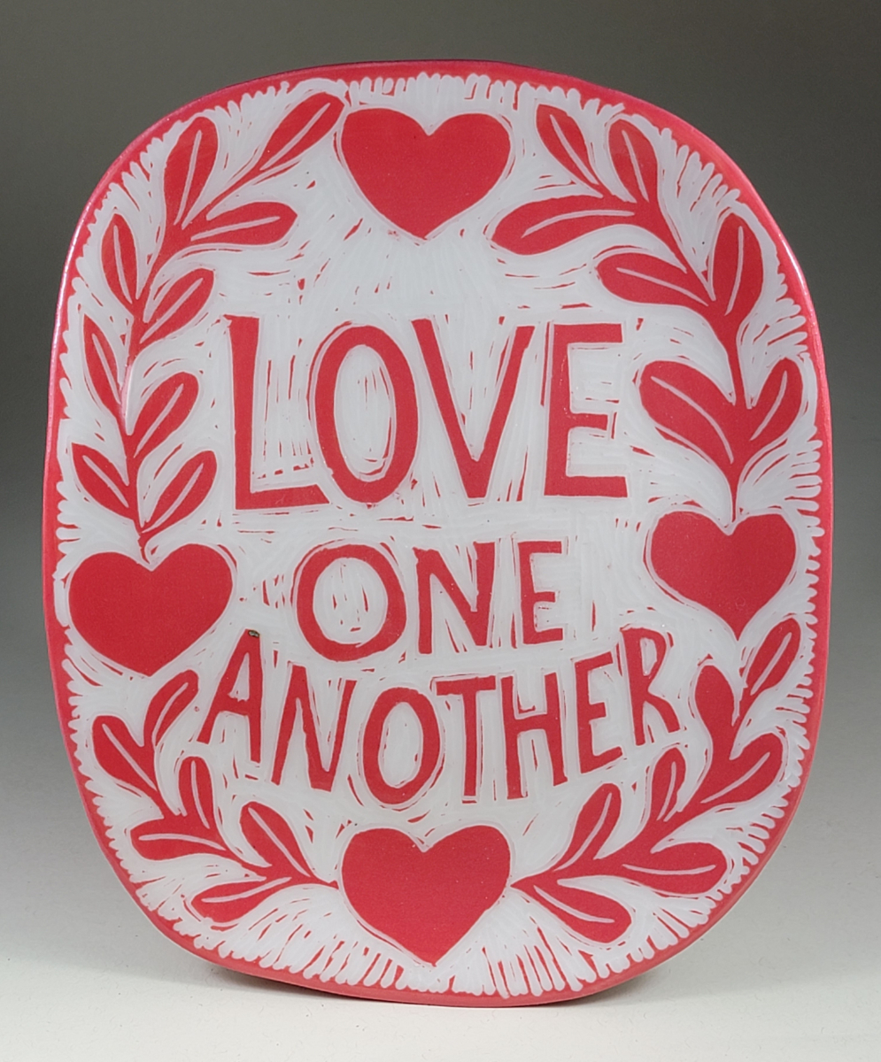 porcelain plate with love one another red sgraffito design
