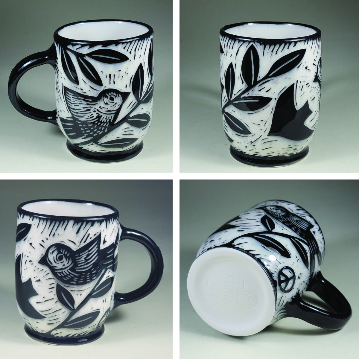 porcelain cup with birds and peace symbols sgrafito design black