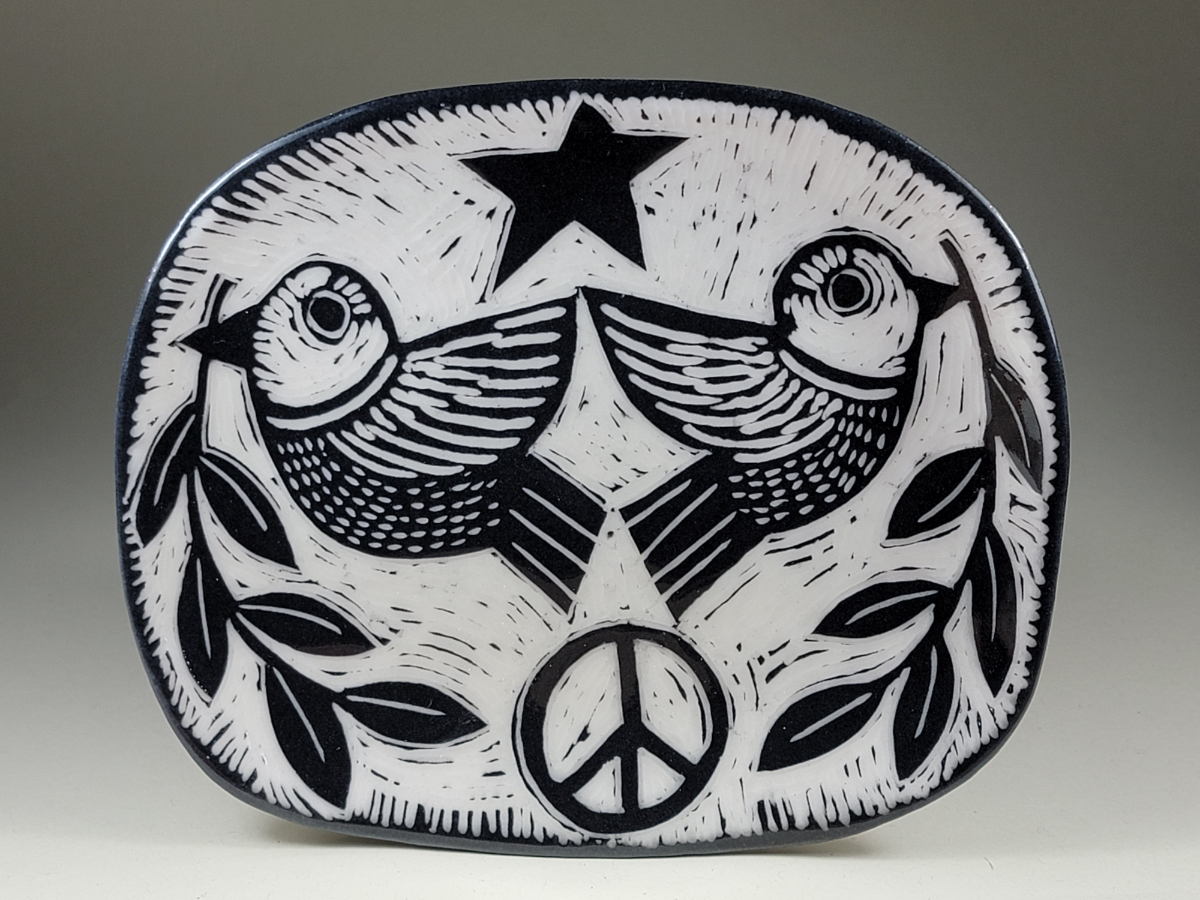 porcelain plate with doves and olive branches peace symbol sgraffito design