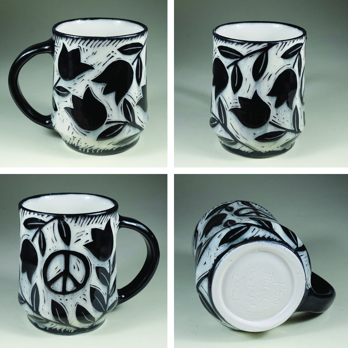 porcelain cup with tulip and peace symbol black sgraffito design